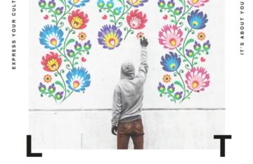 Sprayer mit Kapuze sprüht Blumen Kunstwerk an die Wand express your cult it's about you